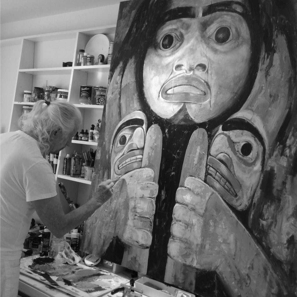 Paul Ygartua painting in his studio a native west coast painting.